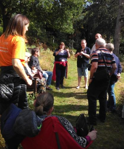 Exploring wild plants in burial grounds with British Sign Language users.